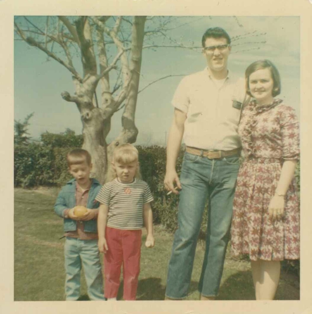 Me with Uncle John, circa 1967, Kerman, Calif. The boy on the left is our neighbor; the woman on the right is John's first wife.